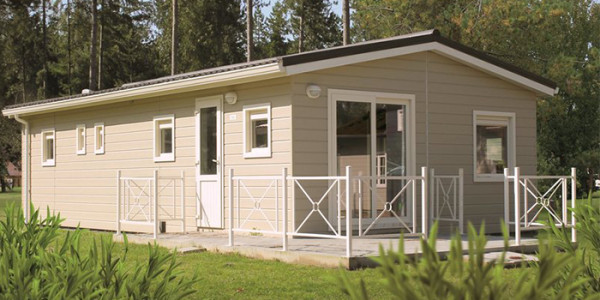 Een zespersoons bungalow Greenhouse Sigma op het park Molenheide in België. vakantiesvoorgrotegezinnen.nl
